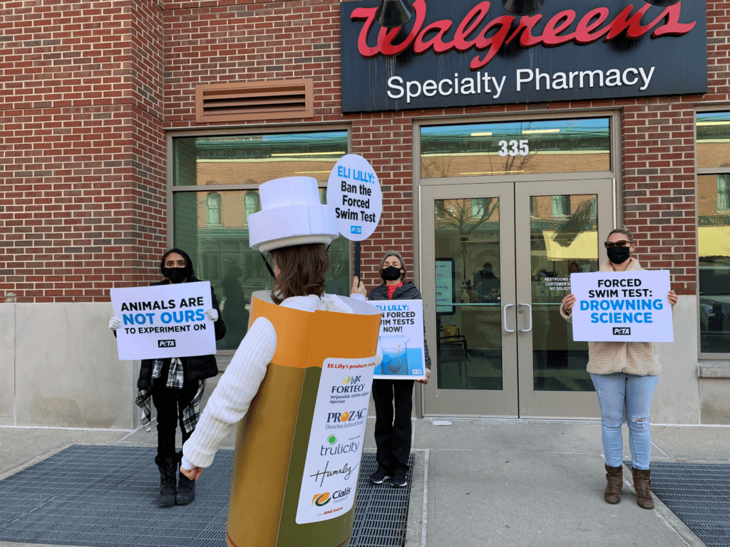 PETA Protesters in front of pharmacy