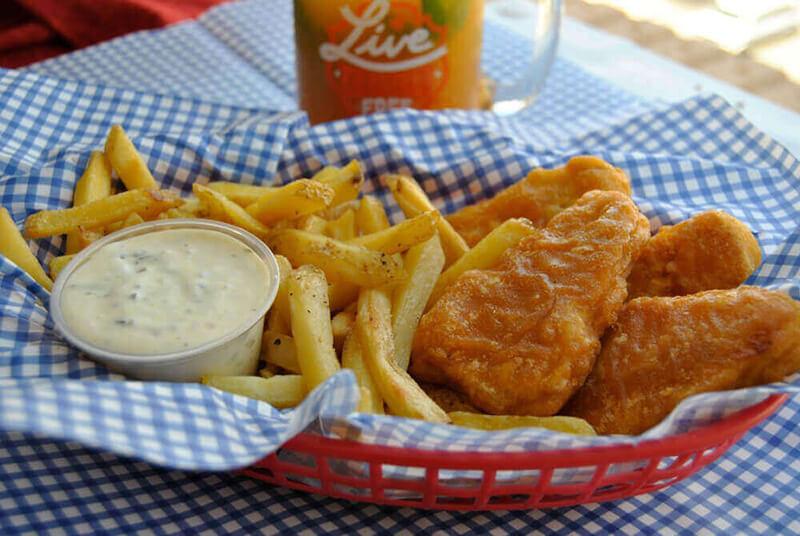 Gardein vegan fish fillets, fries, and vegan tartar sauce in a basket