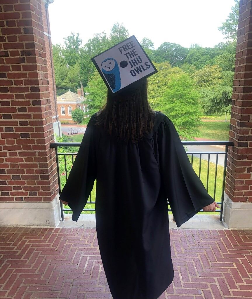 Person wearing graduation cap at Johns Hopkins University