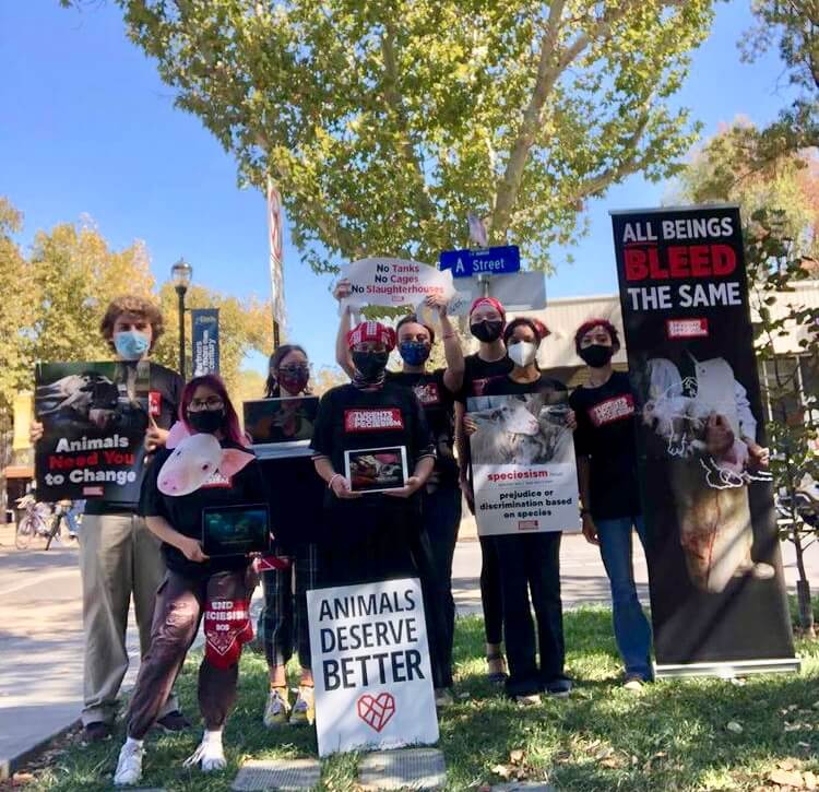 Student demonstrating with SOS to end speciesism